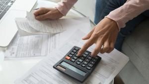 Businessman Calculating His Debts