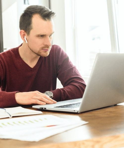 Man With Airpods On Laptop