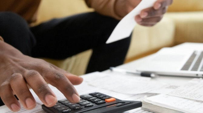 Man Calculating His Household Bills